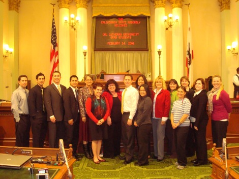 CLU Grad Students Posing on the Floor of the State Assembly